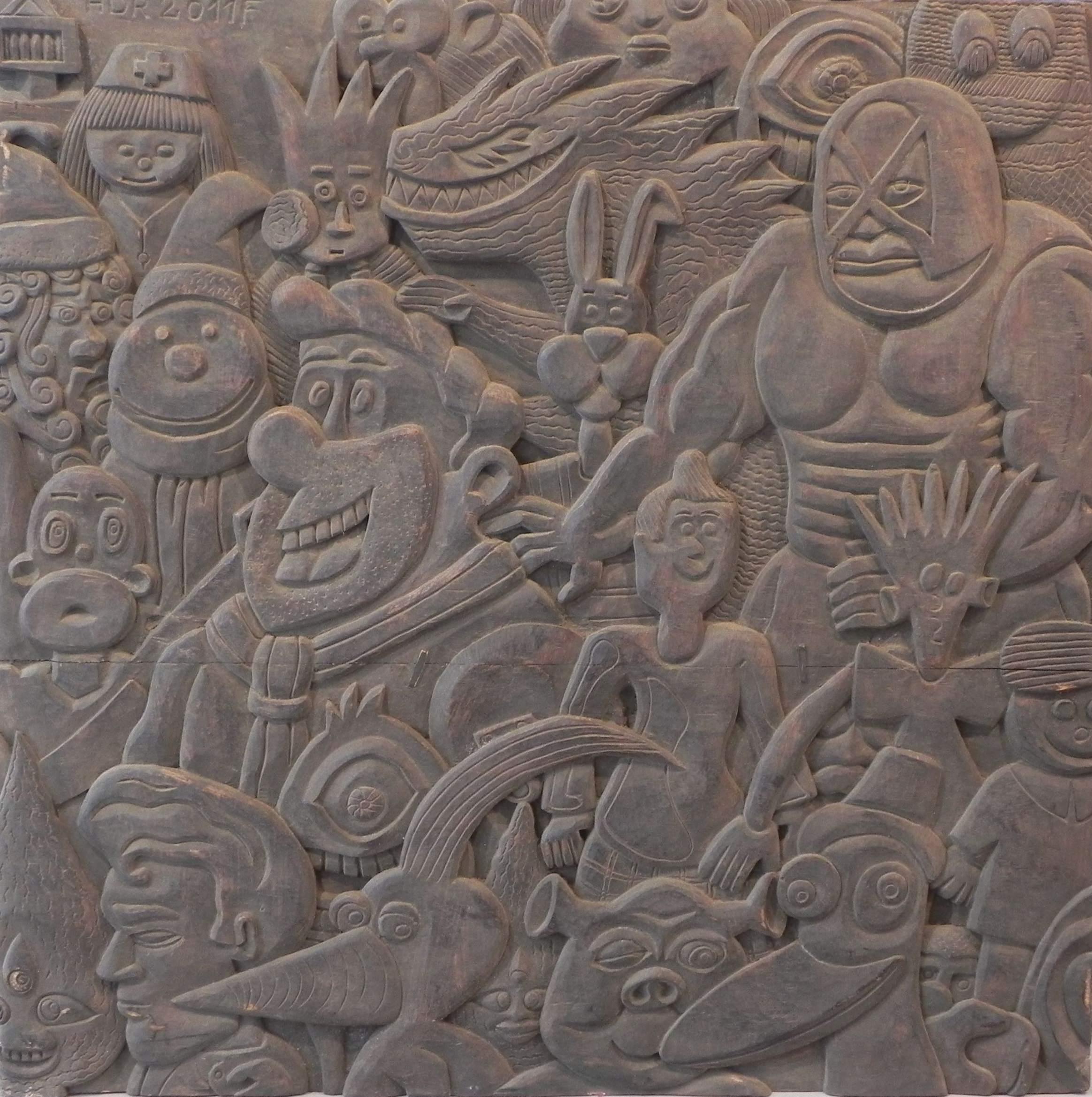 Bas relief en bois, réalisé lors d'un séjour@à Foumban (Cameroun)