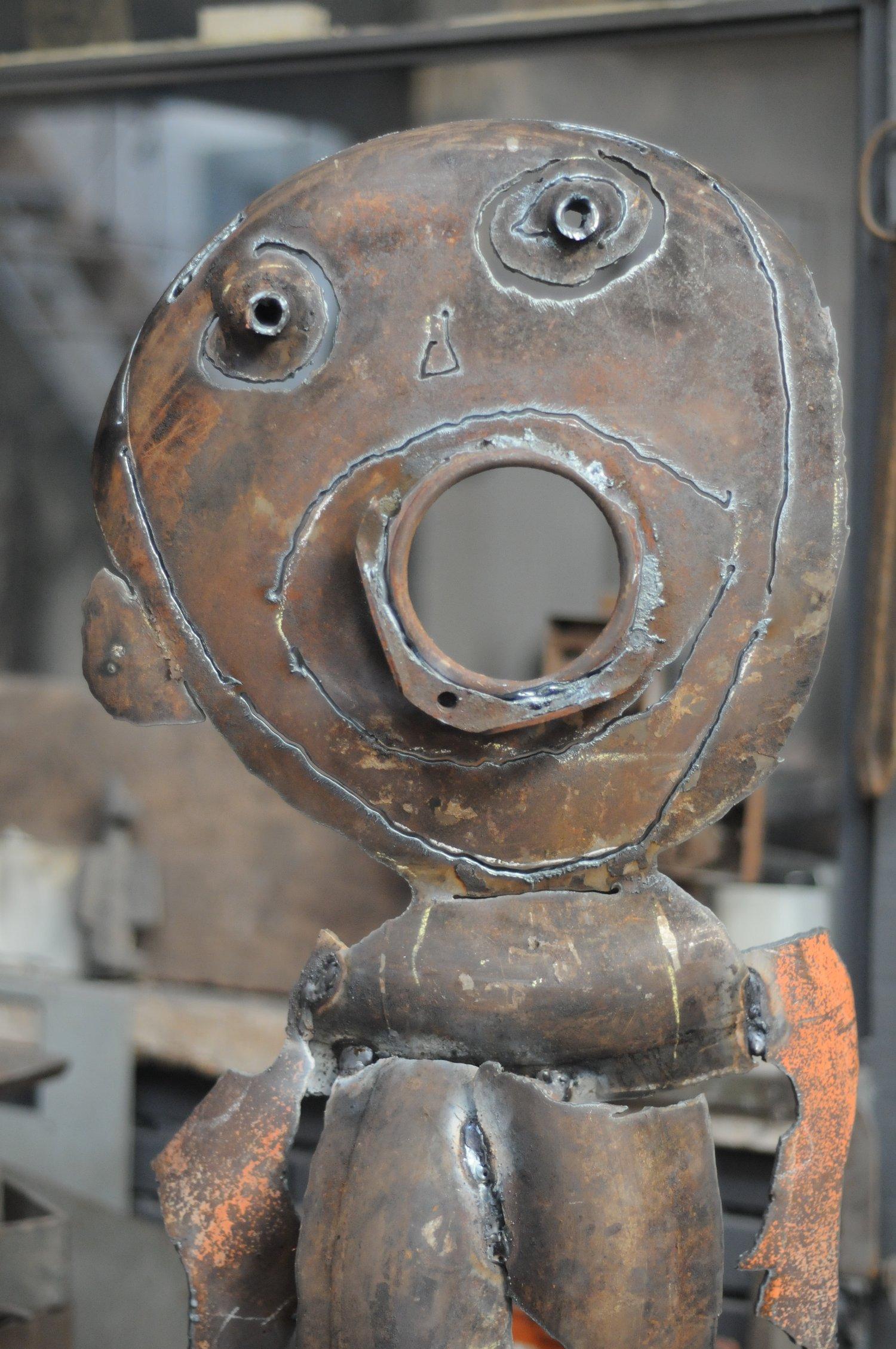 L'homme à la bourre (détail), métal découpé (140 cm)